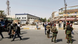 Iraqi security forces gather at the site of a suicide bomb blast in Baghdad
