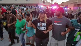 Protesters march through the street during a rally in El Cajon, a suburb of San Diego