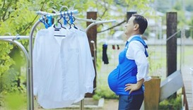 Politicians wear 'pregnancy' vests to urge men to help at home