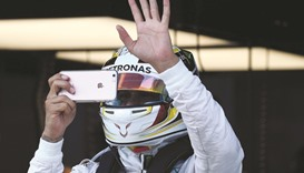 Hamilton finds groove in Sepang
