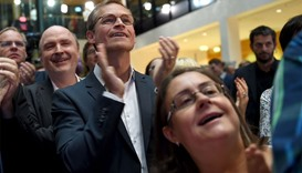 Berlin's Mayor Michael Mueller of the Social Democrats (SPD) reacts as exit polls were announced