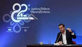 Greek PM urges IMF to decide on bailout participation