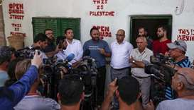 Prominent Palestinian activist Issa Amro speaks to journalists after he was released on bail by a Pa