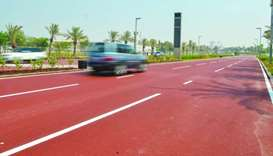 Paved in crimson, Qatar's first-of-its-kind 'red' street now open
