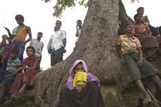 24 bodies wash up as Rohingyas flee