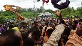 Newly arrived Rohingya refugees scuffle for relief supplies at Kutupalong refugee camp