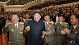 North Korean leader Kim Jong-Un (front 2nd L) attending an art performance dedicated to nuclear scie