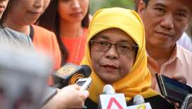 Halimah Yacob talking to reporters outside the Elections Department in Singapore