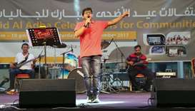 A singer performs at Asian Town