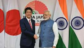 Japanese Prime Minister Shinzo Abe (L) and Indian Prime Minister Narendra Modi