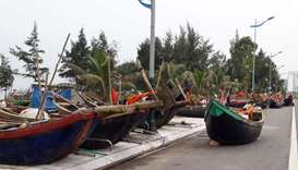 Fishing boat are seen moved onto a road near a beach in the central province of Thanh Hoa