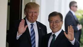US President Donald Trump  (L) with South Korean President Moon Jae-in