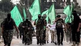 Masked youth cadets from the armed wing of the Palestinian Hamas movement