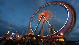 Visitors ride a ferris wheel during the opening day of the 184th Oktoberfest in Munich, Germany