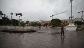 A man walks in a square as Hurricane Maria approaches in Pointe-a-Pitre, Guadeloupe island. Reuters