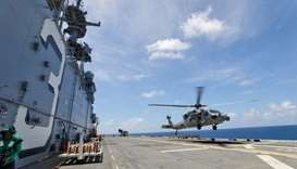 Navy MH-60S Sea Hawk lifts off from flight deck of USS Kearsarge as US military continues to evacuat