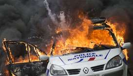 A police car as it explodes after being set on fire during an unauthorized counter-demonstration aga