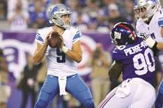Stafford's two TD passes help Lions beat Giants