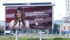 A billboard advertisement for the American Institute school in Zagreb featuring an image of the US F