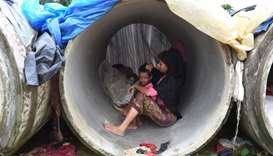 Rohingya Muslim refugees shelter in cement pipes at Kutupalong refugee camp in the Bangladeshi distr