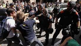 Catalan regional police officers 'Mossos D'Esquadra' try to disperse protesters in front of the head
