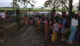 People displaced from communal violence boarding a boat at the Buthidaung jetty