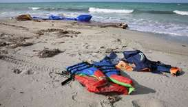 Life jackets are seen washed up on a beach yesterday after dozens of migrants drowned in a shipwreck