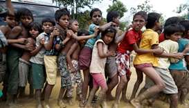 Rohingya refugee children queue for aid in Cox's Bazar, Bangladesh