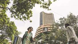 Sensex sinks 448 points; rupee recovers from its near six-month low