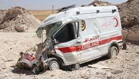 A destroyed ambulance from the Syrian Civil Defence is seen in the town of Khan Sheikun in Idlib pro