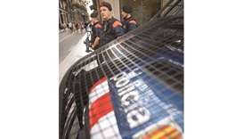 Catalan police, known as Mossos d'Esquadra, stand guard in downtown Barcelona yesterday.