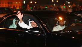 His Highness the Emir Sheikh Tamim bin Hamad al-Thani waves at the welcoming citizens and residents