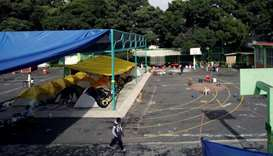 Tents are set up at a school turned shelter for people whose homes were damaged in an earthquake, in