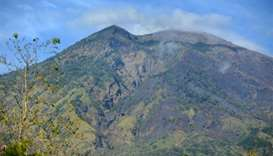 Bali's menacing volcano puts tourists' plans on back burner