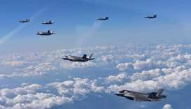 US Marine Corps F-35B fighter jets and South Korean air Force's F-15K fly over South Korea during a