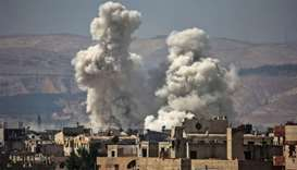 Smoke billows following bombardment on the outskirts of the capital Damascus.
