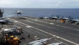An F/A-18 Super Hornet lands on the deck of the USS Ronald Reagan in the South China Sea