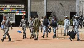Police in front of  the Ivory Coast prison
