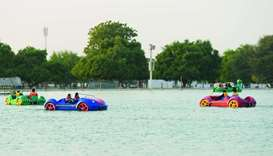 Children enjoying the boat ride at Aspire Park