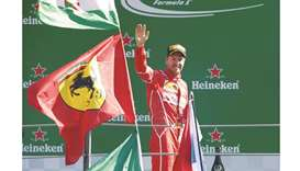 Vettel still smiling after difficult day