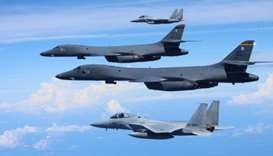 Japan's Self-Defense Forces F-15 fighter jets conduct an air exercise with U.S. Air Force B-1B Lance