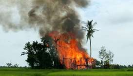 A house is seen on fire in Gawduthar village, Maungdaw township, in the north of Rakhine state, Myan