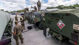 South Carolina National Guard soldiers transfer bulk diesel fuel into fuel tanker trucks for distrib