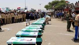 Mourners attend a funeral of people, mainly children, killed in a Saudi-led coalition air strike on