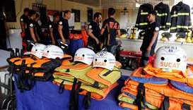 Rescuers ready their gear before Super Typhoon Mangkhut hits the main island of Luzon in Manila