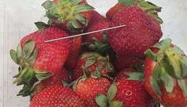 Strawberries sabotaged with needles
