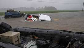 A pickup truck is seen submerged in floodwater in Lumberton, North Carolina