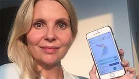 Gillian Collins, a Sidra Medicine patient. with 10 moons mobile app