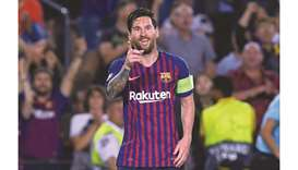 Messi hat-trick fires Barcelona to victory over PSV