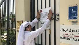 An MEC inspector putting up the closure notice.